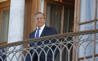 Russian Foreign Minister Sergei Lavrov stands on the balcony before a meeting of President Vladimir Putin with French President Emmanuel Macron (both not pictured) at the Konstantin Palace in Strelna, outside Saint Petersburg, on May 24, 2018. (GRIGORY DUKOR/AFP)