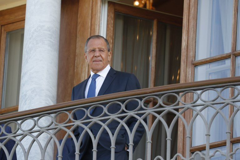 Russian Foreign Minister Sergei Lavrov stands on the balcony before a meeting of President Vladimir Putin with French President Emmanuel Macron at the Konstantin Palace in Strelna outside Saint Petersburg