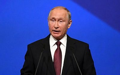 Russian President Vladimir Putin gives a speech at a session of the Saint Petersburg International Economic Forum on May 25, 2018, in Saint Petersburg, Russia. (AFP/Kirill Kudryavtsev)