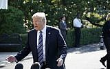 US President Donald Trump speaks to the press on his way to board Marine One from the South Lawn of the White House on May 25, 2018. (AFP Photo/Mandel Ngan)