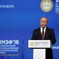 Russian President Vladimir Putin gives a speech at a session of the Saint Petersburg International Economic Forum on May 25, 2018, in Saint Petersburg, Russia. (AFP Photo/Ludovic Marin)