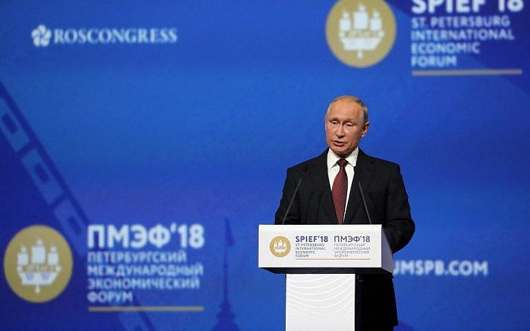 russian president vladimir putin gives a speech at a session of the saint petersburg international economic