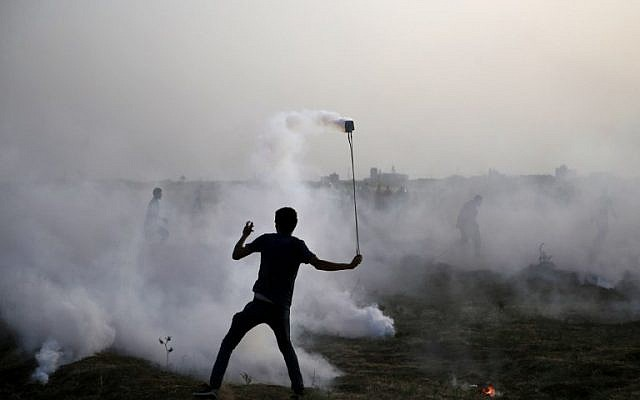 Illustrative image of a Palestinian protester at a demonstration along the border between Israel and the Gaza Strip, east of Gaza City, on May 25, 2018. (AFP/Mohammed Abed)