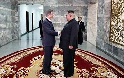 This picture taken on May 26, 2018 and released by the Blue House via Dong-A Ilbo shows South Korea's President Moon Jae-in , left, shaking hands with North Korea's leader Kim Jong Un before their second summit at the north side of the truce village of Panmunjom in the Demilitarized Zone (DMZ). (AFP/ Dong-A Ilbo / Handout)