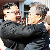 South Korea's President Moon Jae-in (R) hugs North Korea's leader Kim Jong Un after their second summit at the north side of the truce village of Panmunjom in the Demilitarized Zone (DMZ) on May 26, 2018 (AFP PHOTO / Dong-A Ilbo)