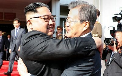 This picture taken on May 26, 2018 and released by the Blue House via Dong-A Ilbo shows South Korea's President Moon Jae-in (R) hugging North Korea's leader Kim Jong Un after their second summit at the north side of the truce village of Panmunjom in the Demilitarized Zone (DMZ). (AFP PHOTO / Dong-A Ilbo)