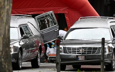 Hearses are pictured inside the security perimeter set by the police at the scene of a shooting in Liege, on May 29, 2018, after a gunman shot dead three people, two of them policemen, before being killed by elite officers (AFP PHOTO / BELGA / ERIC LALMAND)