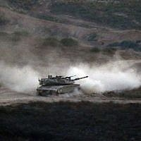 An Israeli army tank patrols along the border between Israel and the Gaza Strip on May 29, 2018. (Jack GUEZ/AFP)