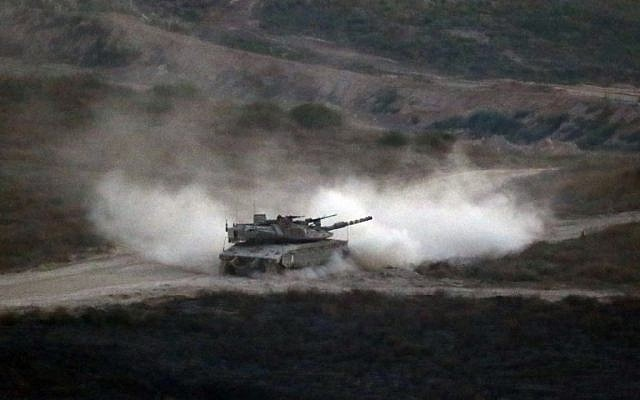 Illustrative: An Israeli army tank patrols along the border between Israel and the Gaza Strip on May 29, 2018. (Jack GUEZ/AFP)