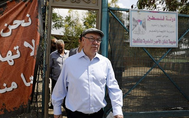 Alistair Burt, British Minister of State for the Middle East and North Africa, visits the Khan al-Ahmar Bedouin village in the West Bank, May 30, 2018. (Menahem Kahana/AFP)