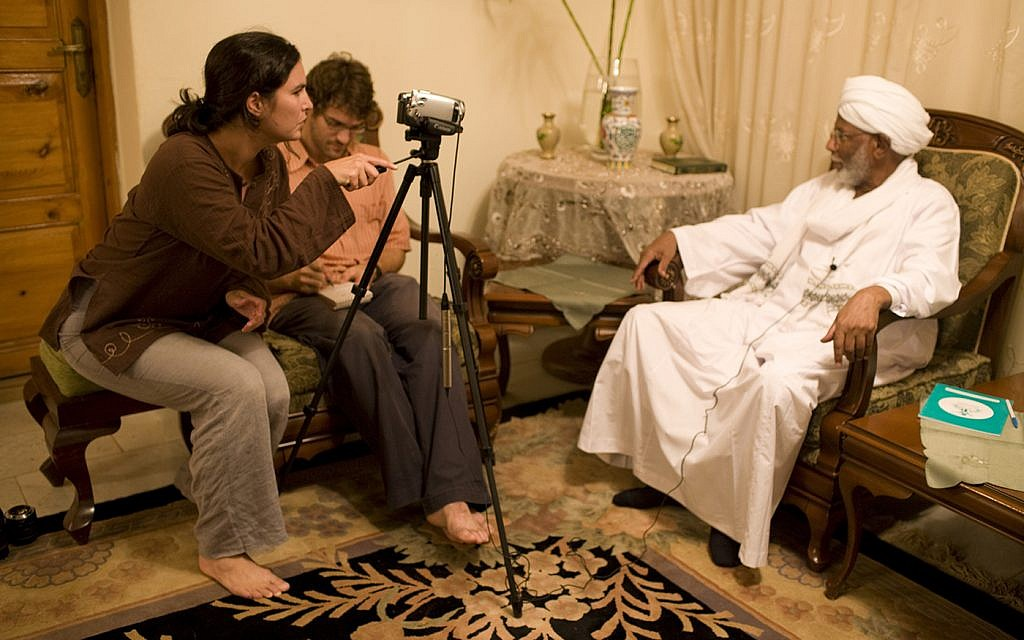 New York Times reporter Jeffrey Gettleman and wife Courtenay interview one of Sudan's 'most dangerous, intelligent and whimsical intellectuals,' Hassan Al-Turabi. Khartoum, Sudan. (courtesy)