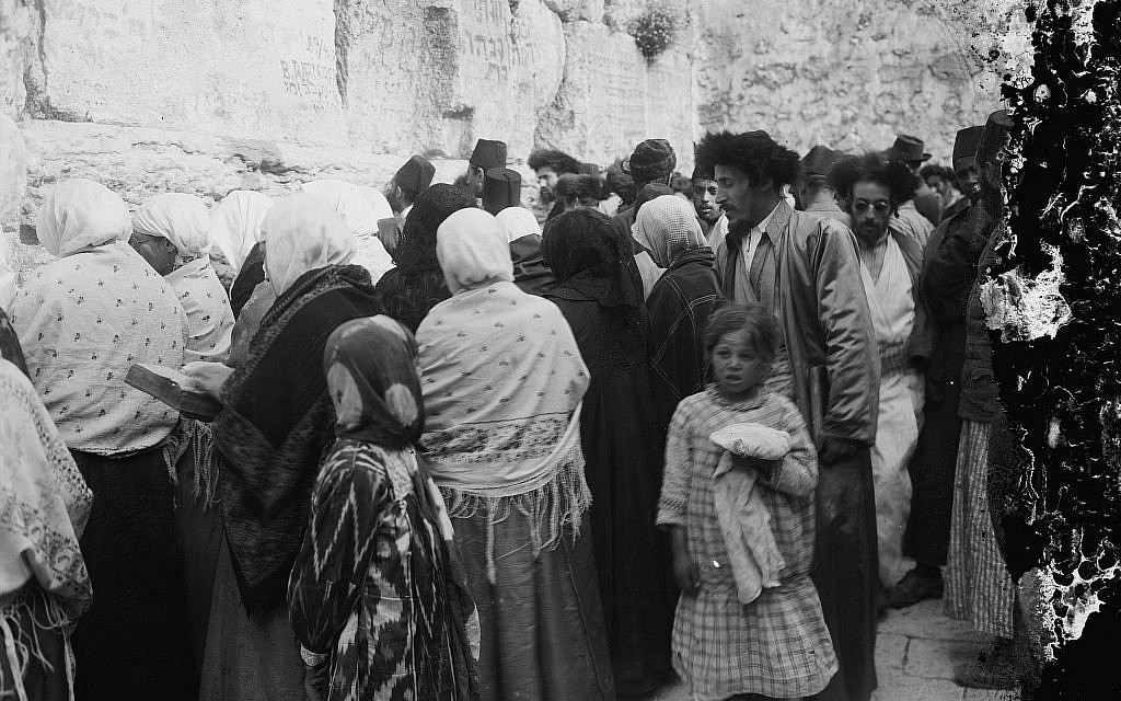 Men and women pray side by side at the Western Wall, ca. 1898-1946. (American Colony)