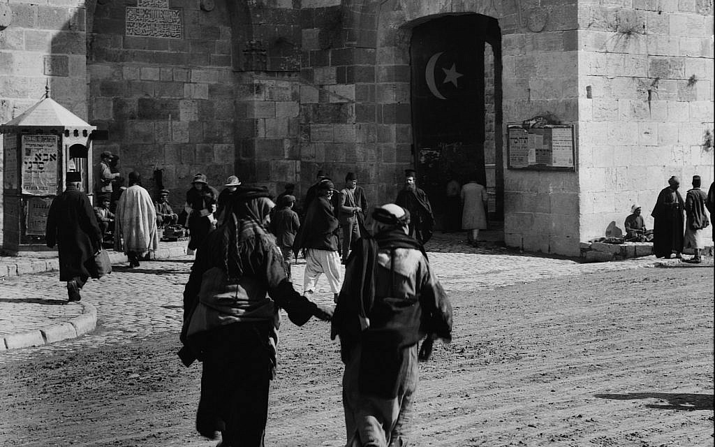 Exact location unknown, men walking towards the Old City, Turkish flag visible in gate. (Unknown)