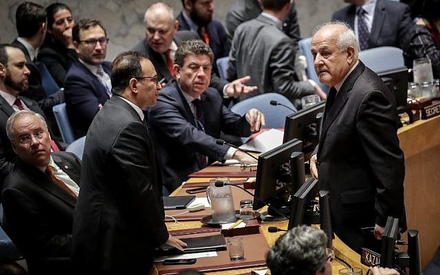 Kuwait's Ambassador to the United Nations Mansour Al-Otaibi, left, talks to Permanent Observer of Palestine to the United Nations Riyad Mansour at the start of a UN Security Council meeting, May 15, 2018 in New York. (Drew Angerer/Getty Images/AFP)