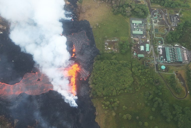 Lava destroys warehouse at power plant site