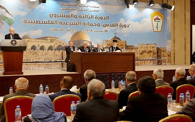 Palestinian Authority President Mahmoud Abbas (seated center), during the second day of the Palestinian National Council, on May 1, 2018. (Asil Shahin/Wafa)