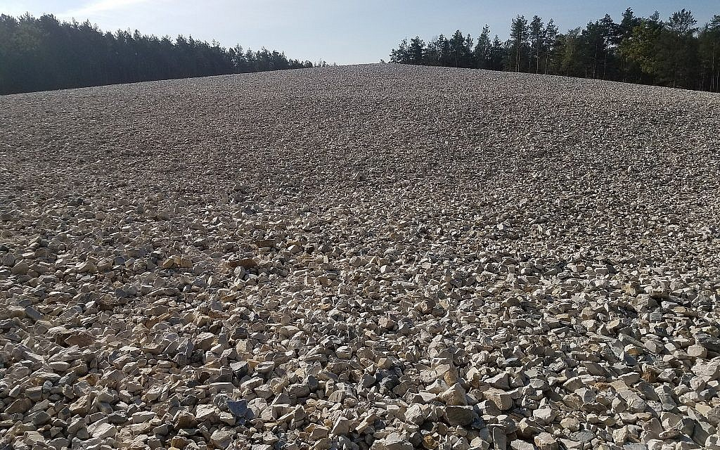 At the former Nazi death camp Sobibor, in Poland, a sprawling mound of crushed granite was placed atop the mass graves area in recent years, October 2017 (Matt Lebovic/The Times of Israel)