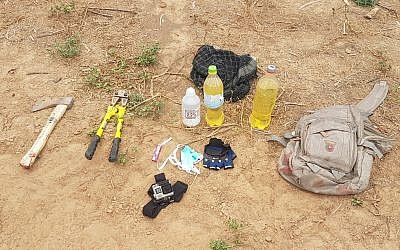 An axe, lighter fluid, gloves, wirecutters and a lighter, which were in the possession of three Palestinian men who were shot dead as they entered Israeli territory from the Gaza Strip on May 6, 2018. (Israel Defense Forces)