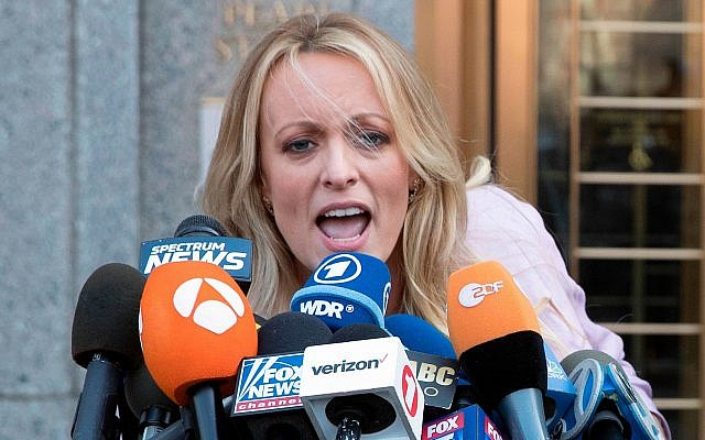 In this April 16, 2018 photo, adult film actress Stormy Daniels outside federal court in New York. Stormy Daniels filed a defamation complaint in federal court in New York on Monday. (AP Photo/Mary Altaffer)