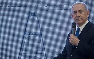 Prime Minister Benjamin Netanyahu presents material on Iranian nuclear weapons development during a press conference in Tel Aviv, April 30 2018. (AP Photo/Sebastian Scheiner)