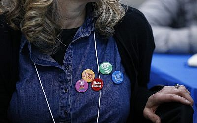 A member of the Sisterhood of Salaam Shalom group wears politically-themed buttons during a visit to the McRae Learning Center in Selma, Alabama, April, 24, 2018. (Brynn Anderson/AP)