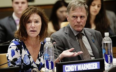 Fred Warmbier, right, listens as his wife Cindy Warmbier speaks of their son Otto Warmbier, an American who died last year, days after his release from captivity in North Korea during a meeting Thursday, May 3, 2018, at the United Nations headquarters. (AP/Frank Franklin II)