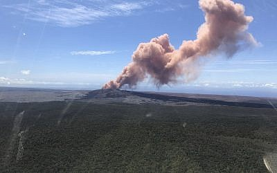 In this photo provided by the US Geological Survey, red ash rises from the Puu Oo vent on Hawaii's Kilauea Volcano after a magnitude-5.0 earthquake struck the Big Island, Thursday, May 3, 2018 in Hawaii Volcanoes National Park. (Kevan Kamibayashi/US Geological Survey via AP)