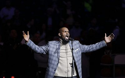 Musical artist R. Kelly performs the national anthem before an NBA basketball game between the Brooklyn Nets and the Atlanta Hawks in New York, November 17, 201 (AP Photo/Frank Franklin II, File)