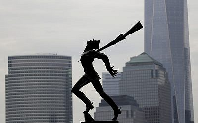Buildings in Lower Manhattan provide a backdrop to a statue dedicated to the victims of the Katyn massacre of 1940, on May 4, 2018, in Jersey City, New Jersey.  (AP Photo/Julio Cortez)