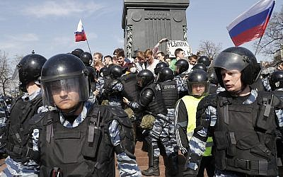 Russian police push protesters back during a demonstration against President Vladimir Putin in Pushkin Square in Moscow, Russia, Saturday, May 5, 2018.  (AP Photo/Pavel Golovkin)