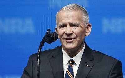 In this May 4, 2018 photo, former US Marine Lt. Col. Oliver North speaks before giving the Invocation at the National Rifle Association-Institute for Legislative Action Leadership Forum in Dallas. (AP Photo/Sue Ogrocki)