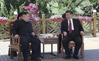 In this photo taken between May 7 and 8, 2018 released by Xinhua News Agency, Chinese President Xi Jinping, (R) speaks to North Korean leader Kim Jong Un in Dalian in northeastern China's Liaoning Province. (Ju Peng/Xinhua via AP)