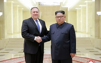 In this May 9, 2018, photo provided on May 10, 2018, by the North Korean government, US Secretary of State Mike Pompeo, left, poses with North Korean leader Kim Jong Un in Pyongyang, North Korea. (Korean Central News Agency/Korea News Service via AP)