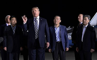 US President Donald Trump speaks as he stands with Tony Kim, second left, Kim Dong Chul, center right, and Kim Hak Song, right, three Americans detained in North Korea for more than a year, after they arrived at Andrews Air Force Base in Md., Thursday, May 10, 2018. Vice President Mike Pence, left, and Secretary of State Mike Pompeo, second from right, listen. (AP Photo/Susan Walsh)