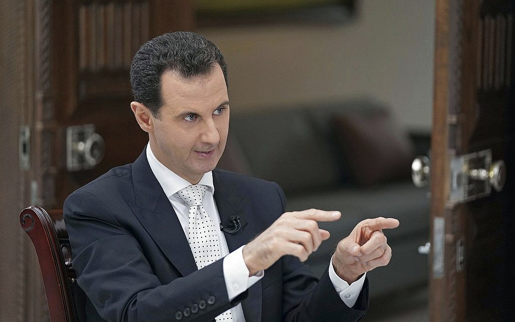 Syrian President Bashar Assad speaks during an interview with the Greek Kathimerini newspaper, in Damascus, Syria, in this photo released May 10, 2018. (SANA via AP)