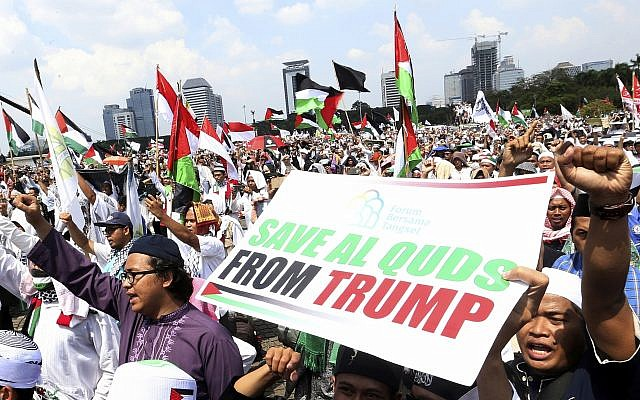 "Protesters shout ""God is Great"" during a rally against the US plan to move its embassy in Israel from Tel Aviv to Jerusalem, at Monas, the national monument, in Jakarta, Indonesia, on May 11, 2018. (AP Photo/Achmad Ibrahim)"