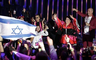 Netta Barzilai from Israel celebrates after winning the Eurovision song contest in Lisbon, Portugal, Saturday, May 12, 2018. (AP Photo/Armando Franca)