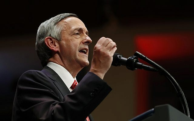 Pastor Robert Jeffress of the First Baptist Dallas Church Choir speaks as he introduces US President Donald Trump during the Celebrate Freedom event at the Kennedy Center for the Performing Arts in Washington, Saturday, July 1, 2017. (AP Photo/Carolyn Kaster)