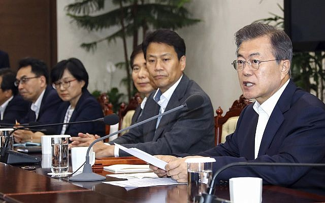 South Korean President Moon Jae-in, right, talks during a meeting with his senior aides at the presidential Blue House in Seoul, South Korea, May 14, 2018. (Bee Jae-man/Yonhap via AP)
