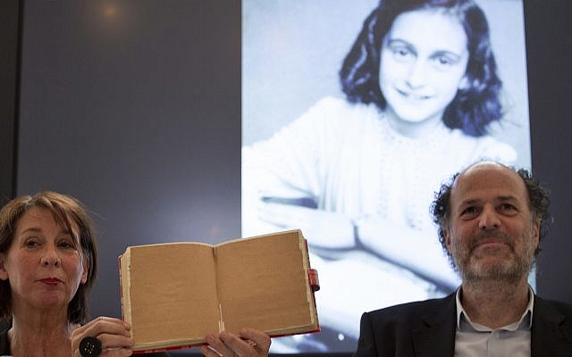 Teresien da Silva, left, and Ronald Leopold of the Anne Frank Foundation show a facsimile of Anne Frank's diary with two pages taped off during a press conference at the foundation's office in Amsterdam, Netherlands, Tuesday, May 15, 2018.  (AP Photo/Peter Dejong)