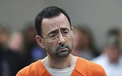 In this file photo from November 22, 2017, Dr. Larry Nassar appears in court for a plea hearing in Lansing, Michigan. (AP Photo/Paul Sancya, File)