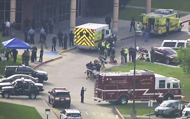 In this image taken from video, emergency personnel and law enforcement officers respond to a high school near Houston after an active shooter was reported on campus, on May 18, 2018, in Santa Fe, Texas. (KTRK-TV ABC13 via AP)
