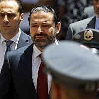 Outgoing Lebanese Prime Minister Saad Hariri, center, arrives to parliament to attend a session for the election of the house speaker, in Beirut, Lebanon, Wednesday, May 23, 2018. (AP Photo/Hussein Malla)