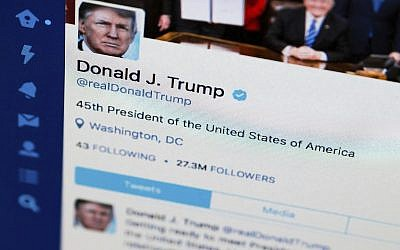 This April 3, 2017, photo shows US President Donald Trump's Twitter feed on a computer screen in Washington. (AP Photo/J. David Ake, File)