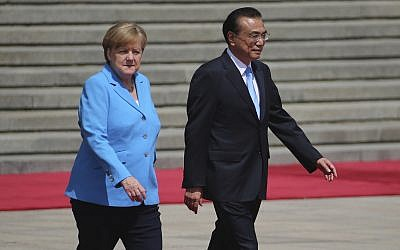 German Chancellor Angela Merkel, left, and Chinese Premier Li Keqiang walk during a welcoming ceremony at the Great Hall of the People in Beijing, May 24, 2018. (Wu Hong/Pool Photo via AP)