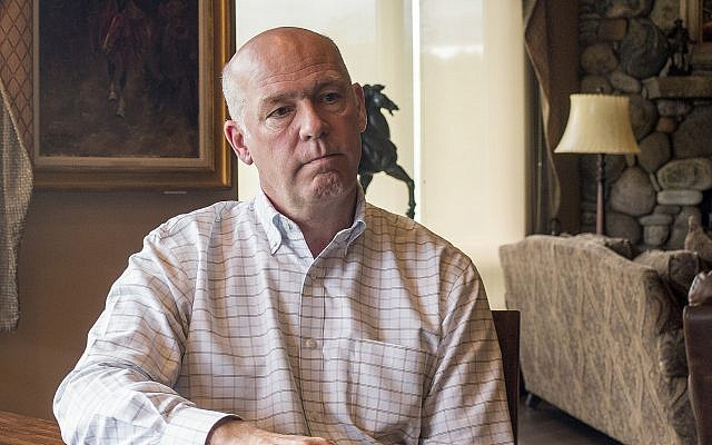 In this June 20, 2017, photo, Montana Rep.-elect Greg Gianforte responds to questions at his home in Bozeman, Mont., about an election-eve confrontation with a reporter. (AP Photo/Bobby Caina Calvan,)