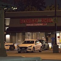 Police stand outside the Bombay Bhel restaurant in Mississauga, Canada Friday, May 25, 2018 (Doug Ives/The Canadian Press via AP)