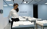 In this photo taken on Wednesday, May 23, 2018, architect Deborah Pinto Fdeda looks part of the installation at the Israeli pavilion, at the Biennale International Architecture exhibition, in Venice, Italy (AP/Antonio Calanni)
