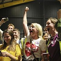 "People from the ""Yes"" campaign react, as the results of the votes begin to come in the Irish referendum on the 8th Amendment of the Irish Constitution at the RDS count centre, in Dublin, Ireland, Saturday May 26, 2018. Ireland appeared to move away from its conservative Roman Catholic roots and embrace a more liberal view Friday as two major exit polls predicted voters had repealed a constitutional ban on abortion. (AP Photo/Peter Morrison)"