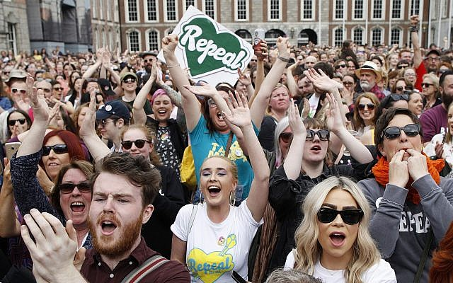 "People from the ""Yes"" campaign react as the results of the Irish referendum on the 8th Amendment of the Irish Constitution are heard, at Dublin Castle, in Dublin, Ireland, on May 26, 2018. (AP Photo/Peter Morrison)"